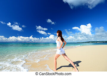 Woman have a stretch on the beach
