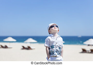 toddler at the beach - cute toddler at the empty tropical...