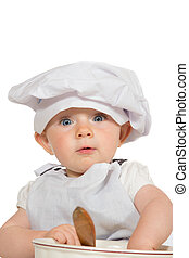 Adorable baby in chefs hat playing with a wooden spoon and...