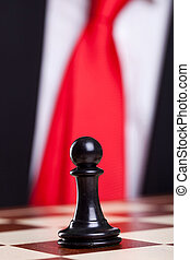 close-up picture of a black chess pawn