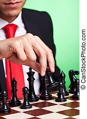 business man playing chess black makes first move