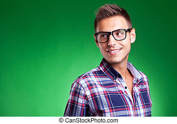 Young casual man with glasses looking away - Attractive...