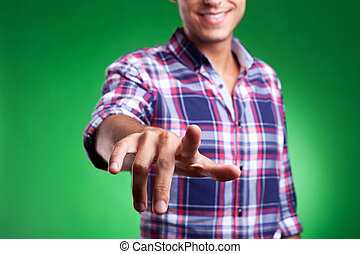 man pinting or pushing imaginary button - cropped picture of...