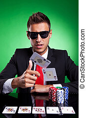 Poker player throwing two ace cards - Poker player, on a...