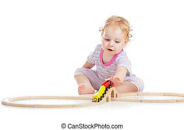 child is playing with wooden train isolated on white