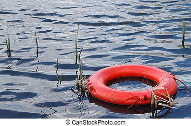 survival metaphor - buoyancy aid floating in water