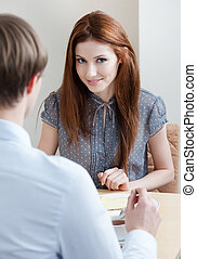 Woman talks with man at the coffee bar - Woman talks with...