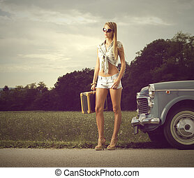Young sexy girl on the road - Young sexy girl with suitcase...