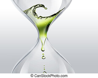 time flows - hourglass with green dripping water close-up