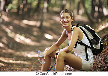 Female nordic walker - Smiling woman with walking sticks in...