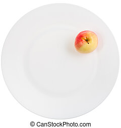 yellow red apple on white plate