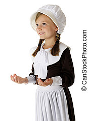 Giving Thanks - An adorable young pilgrim girl looking...
