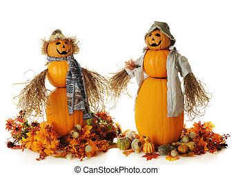 Happy Pumpkin Couple - Two snowman-like pumpkin people,...