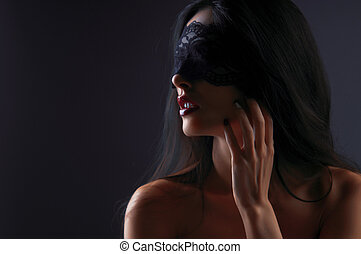 portrait of a girl in a mask with a gray background