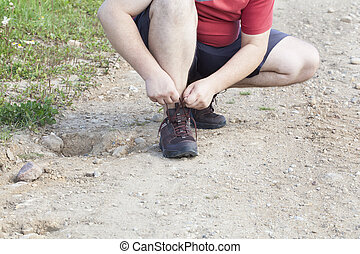 Man tied shoe laces on the trail front view
