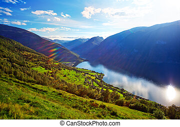 Norway fjord landscape with sun rays.