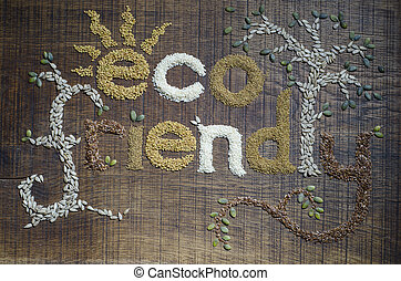 The phrase 'Eco Friendly', written and decorated in seeds -...