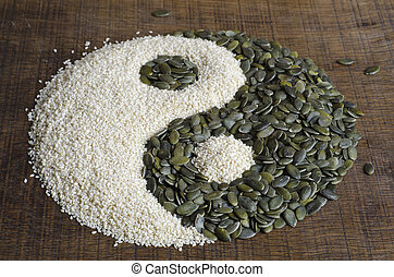 The yin yang created out of pumpkin seeds and sesame seeds...