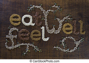 The phrase Eat Well, Be Well, written and decorated in seeds...