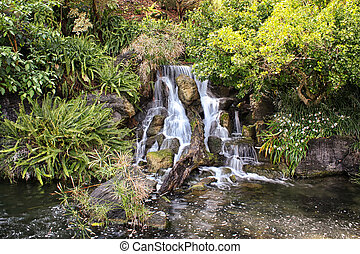 Tranquil Waterfall - Whispy Waterfall with brilliant green...