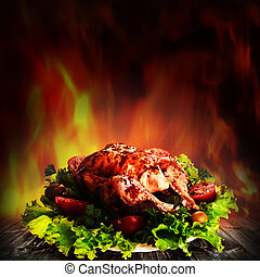 Grilled chicken over salad on the wooden desk