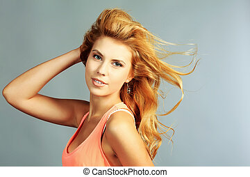 lightness - Portrait of a young woman with beautiful hair.