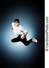 hip hop - Young man dancing hip-hop at studio.