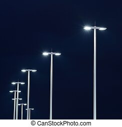 Street Lights - Modern street lights illuminated at night...