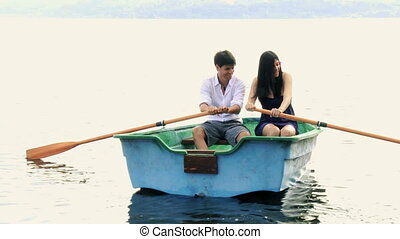 Handsome man rowing boat