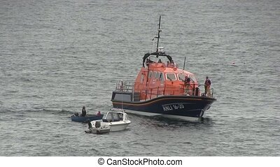 Life boat aiding a boat of the English coast.