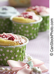 handmade cup cake - handmade colorful cup cakes shot in a...