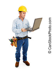 Contractor & Computer Full Body - Full body view of a...