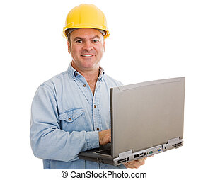 Contractor with Laptop - Construction contractor using his...