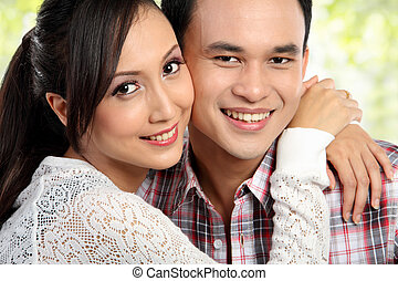 Happy young couple embracing - close up portrait Happy young...