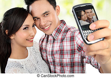 young couple taking self portrait - Closeup of lovely young...