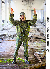 The woman in military uniform surrenders