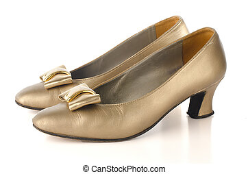 Gold high-heeled shoes isolated on white background.