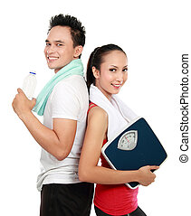 sporty woman and man - Portrait of sporty healthy young...