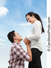 man proposing to girlfriend - Young man romantically...
