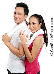 Fitness Smiling young couple man and woman - portrait of...