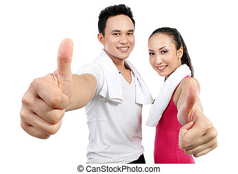 Good health - portrait of fitness woman and man showing...