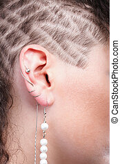 Ear super piercing woman hair background skin