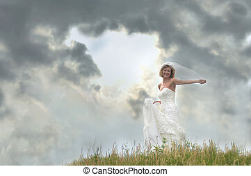 Approaching Storm and Bride - Bride stands atop a hill with...