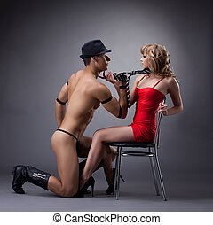 nude man show striptease for sexy girl in red