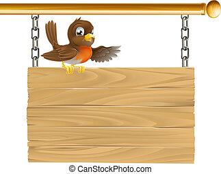 Robin sitting on sign board - A sweet little happy robin...