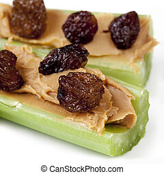 Ants on a Log - Ants on a log. Celery sticks with peanut...