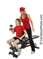 Lifting weights - Caucasian mother helping her preteen...