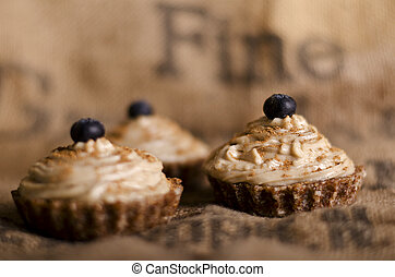 raw food cupcakes with nutcream and blueberry on top, vegan...
