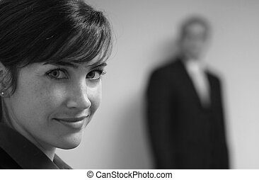 Business team - Business woman in purple looks towards...