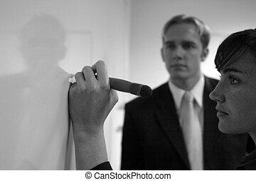 Business team - Businessman and businesswoman standing...